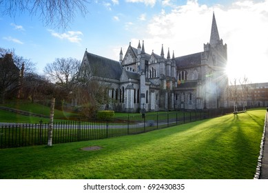 St Patrick's Cathedral, Dublin during autumn season . Green grass and blue sky.