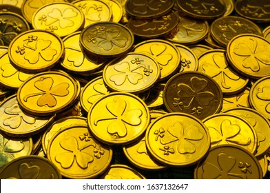 St Patrick's Day background. Golden coins with shamrock, St Patrick's day concept. St Patricks day festive composition with golden coins