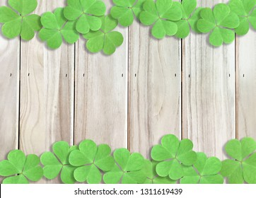St. Patrick's Day Background with Green Shamrocks on Wooden Texture