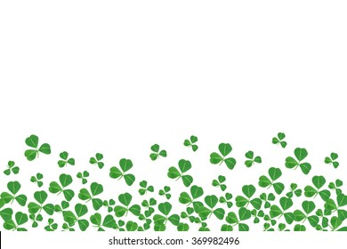 St Patricks Day bottom border of shamrocks over a white background
