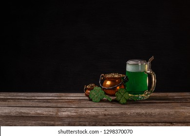 St Patrick's Day concept with green beer and pot of gold, space for your text