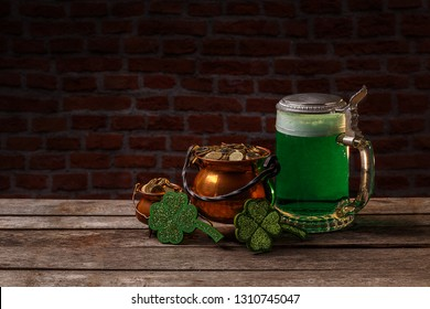 St Patrick's Day concept with green beer and cauldron of gold, space for your text