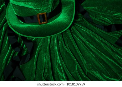 A St. Patrick's day costume hat of a leprechaun. Green Irish hat is on a green background.