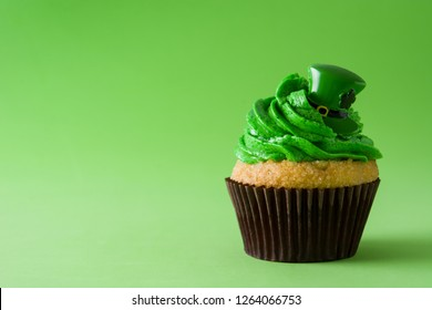 St. Patrick's Day cupcake on green background. Copyspace