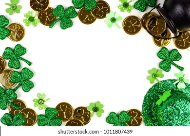 St Patricks Day frame isolated on a white background. Above view with Pot of Gold, shamrocks and leprechaun hat.