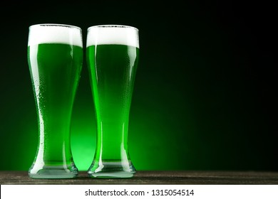 St. Patrick's Day. Glasses of green beer on dark background