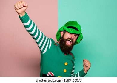 St Patricks day. Hipster with beard wearing green costume for party. Cheerful man celebrate holiday. Christmas elf. Elf concept. Traditions or customs. Happy celebration. Bearded elf. Winter carnival.