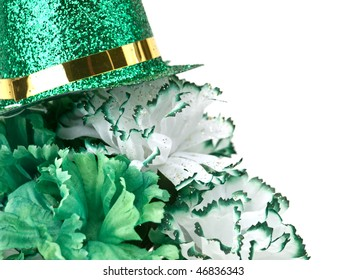 St. Patrick's Day inspired still-life of carnations topped with a glittering top hat on white