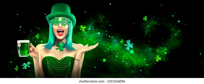 St. Patrick's Day leprechaun laughing model girl pointing hand, holding Green Beer pint on black magic background decorated with shamrock leaves. Patrick Day pub party, celebrating. Border, Widescreen
