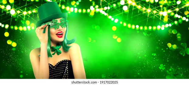 St. Patrick's Day leprechaun laughing model girl on pub. Green Beer pint on magic background decorated with shamrock leaves and garlands. Happy woman on Patrick Day pub party, celebrating. Border