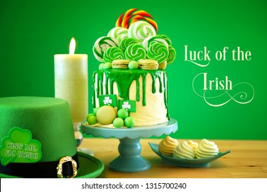 St Patrick's Day party table with lollipop candyland drip cake with Luck of the Irish greeting text.