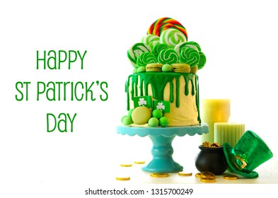 St Patrick's Day party table with lollipop candyland drip cake with Happy St Patrick's Day greeting text.