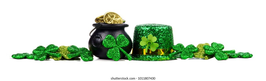 St Patricks Day Pot of Gold, shamrocks and leprechaun hat. Long border over a white background.