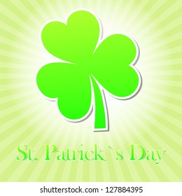 St. Patrick's Day text with green shamrock and striped rays