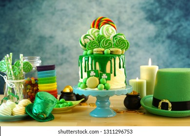 St Patrick's Day theme candyland novelty drip cake and party table.