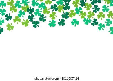 St Patricks Day top border of paper shamrocks over a white background