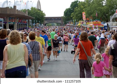 ST. PAUL - AUGUST 26:  Large crowds fill the street at the Minnesota State Fair on August 26, 2012, in St. Paul.  Attendance is averaging 139,000 per day in 2012.