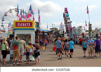 ST. PAUL - AUGUST 26:  People walk through the Midway at the Minnesota State Fair in St. Paul, on August 26, 2012.  Attendance is averaging 139,000 per day in 2012.