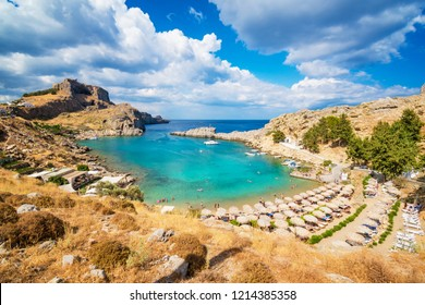 St. Paul bay with boats, Lindos acropolis in background (Rhodes, Greece)