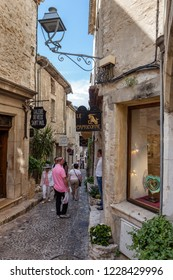 St Paul, France - May 11, 2011: Tourists shopping in the narrow streets of St Paul de Vence in France.