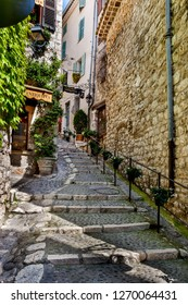 St Paul, France - May 11, 2011: Steep narrow steps lead to antique shops in St Paul de Vence in France.