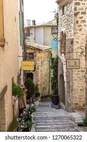 St Paul, France - May 11, 2011: Steep stone staircase leads to shops in the old town of St Paul de Vence in France.