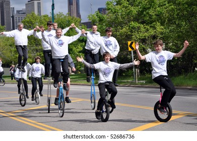 ST. PAUL - MAY 7:  Members of the Twin Cities Unicycle Club entertain the crowd at the Cinco de Mayo parade on May 7,2010 in St. Paul, Minnesota.