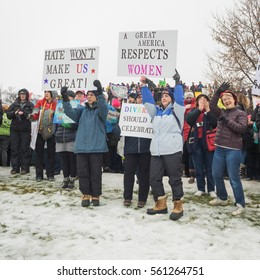 ST. PAUL, MINNESOTA - JANUARY 21, 2017: A group of people hold signs as they wait for the Women's March in St. Paul, Minnesota, to begin on January, 21, 2017.