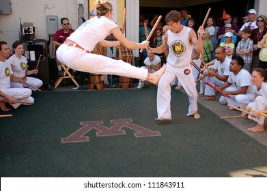 ST. PAUL, MINNESOTA - SEPTEMBER 2:  A demonstration of Capoeira at the Minnesota State Fair on September 2, 2012, in St. Paul, Minnesota.  Capoeira is an art form that combines dance, music and the martial arts.