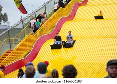 ST. PAUL, MINNESOTA, USA - AUGUST 26, 2018: People enjoying a ride down the Giant Slide at the Minnesota State Fair in the summer of 2018