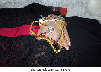 ST PAUL, MINNESOTA USA - FEBRUARY 15, 2016: Deceased Mexican American neighbor lady with a Catholic Rosary placed over her hands.