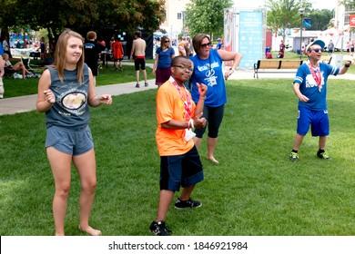 ST PAUL, MINNESOTA / USA - JUNE 23, 2018: Special Olympics members doing tai chi at St. Thomas University