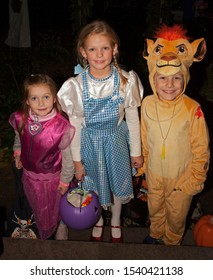 ST PAUL, MINNESOTA / USA - OCTOBER 31, 2016: Dorothy, cowardly lion and a witch from the Wizard of OZ out for a night of Halloween trick or treating.