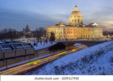 ST. PAUL, MN - FEBRUARY 2018 - A Wide Angle Long Exposure Shot of the State Capitol and distant Cathedral of St. Paul over Lightrail Train Traffic at Dusk