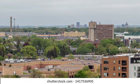ST. PAUL, MN - MAY 2019 - A Shot of the St. Paul Skyline behind the Midway Neighborhood on a Cloudy Spring Day