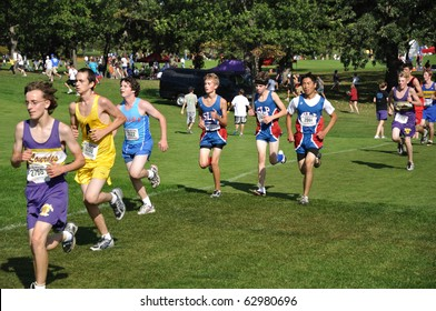 ST. PAUL, MN - SEPTEMBER 26 : Runners from many Minnesota high schools competing in the Roy Griak Invitational Cross Country Meet on September 26, 2009 in St. Paul, MN