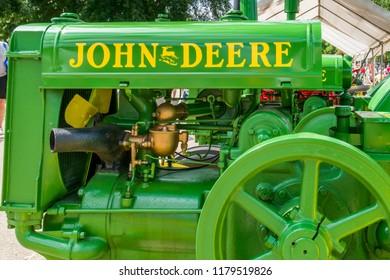 ST. PAUL, MN/USA - AUGUST 29, 2018: Vintage John Deere tractor. John Deere is the brand name of Deere & Company.