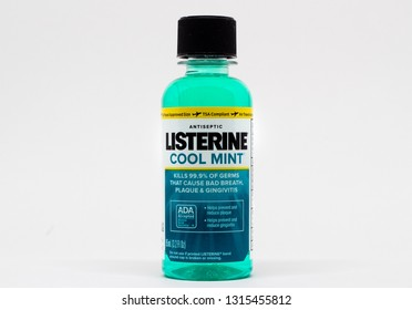 ST. PAUL, MN/USA - FEBRUARY 16, 2019: Listerine mouthwash bottle and trademark logo. Listerine is a brand of antiseptic mouthwash product.
