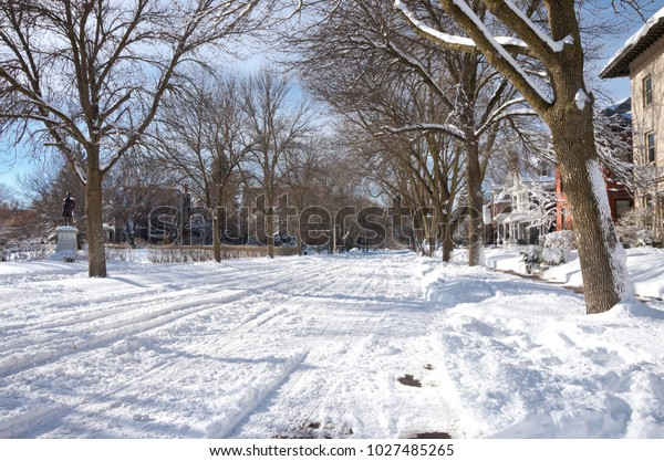 ST. PAUL, MN/USA – JANUARY 23, 2018: Snowy city streets of Saint Paul along Portland Avenue and Nathan Hale Park in Historic Hill District of Summit University neighborhood.