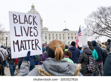 ST. PAUL, MN/USA - MARCH 24, 2018: Unidentified individual carrying Black Lives Matter sign at the March for our Lives protest at the Minnesota State Capitol.