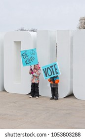 ST. PAUL, MN/USA – MARCH 24, 2018: Young students hold up signs at March For Our Lives rally at State Capitol in St. Paul as part of a nationwide protest against gun violence.
