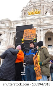 ST. PAUL, MN/USA – MARCH 24, 2018: Students hold up signs to crowd during March For Our Lives rally at State Capitol in Saint Paul as part of a nationwide protest against gun violence.
