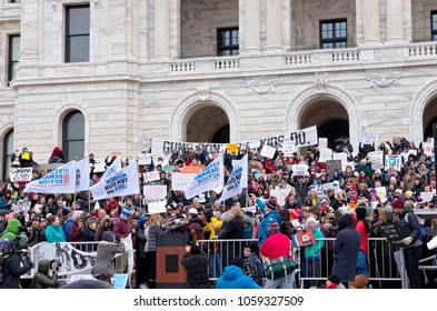 ST. PAUL, MN/USA – MARCH 24, 2018: Students embrace each other after emotional speech at State Capitol during March for Our Lives rally organized as part of a national protest against gun violence.