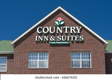 ST. PAUL, MN/USA - MAY 7, 2017: Country Inn and Suite exterior sign and log0. Country Inns and Suites by Carlson is the upper mid-scale hotel brand within the Carlson Rezidor Hotel Group portfolio.
