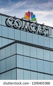 ST. PAUL, MN/USA - SEPTEMBER 30, 2018: Comcast Corporation regional headquarters and trademark logo.