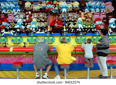 ST. PAUL - SEPTEMBER 4:  Fair goers try their luck at arcade games at the Minnesota State Fair, on Sept. 4, 2011 in St. Paul, Minnesota.  Attendance at the fair has averaged 138,000 per day.