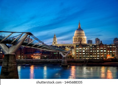 St. Paul's Cathedral across Millennium Bridge and the River Thames in London, UK.