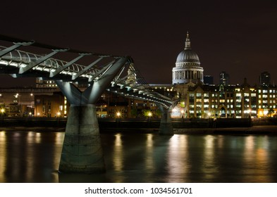 St Paul's Cathedral and the Millenium Bridge in London, seen from the south bank of the Thames