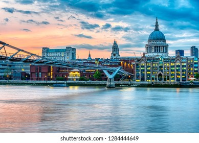 St. Paul's Cathedral and the Millennium Bridge  in London, UK, after sunset