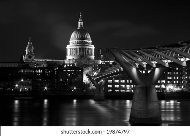 St. Paul's Cathedral on the Thames River with the Millennium Bridge in London, England.